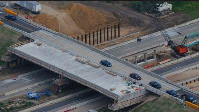 twin three-span bridges carrying eastbound and westbound I-70 traffic over S.R. 121 / New Paris Pike in Wayne County, Ind