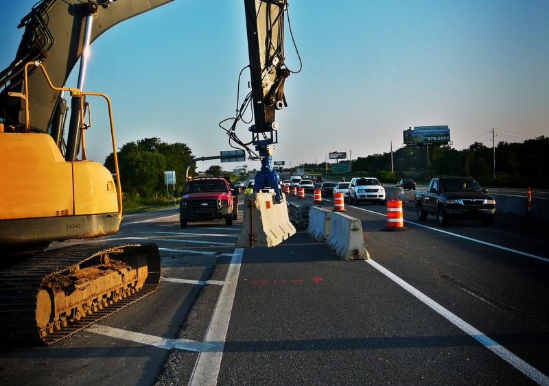 A hydraulic barrier lifter is used to safely maneuver concrete barriers