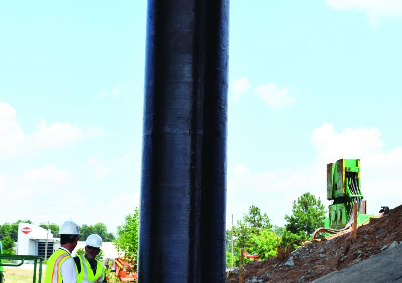 Repaired column strengthened with FRP material