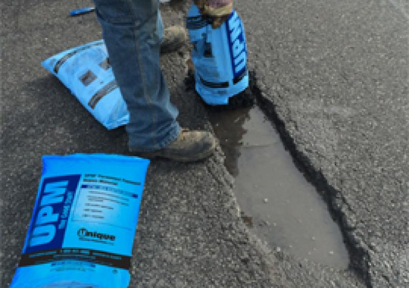 High-performance cold-mix asphalt repair material