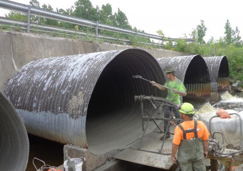 Crew spin-casting arched pipe, Fort Drum, N.Y.