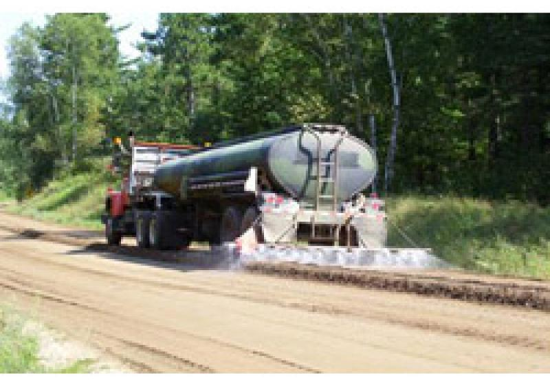 applying BASE ONE, an inexpensive liquid aggregate base stabilizer that is applied with water