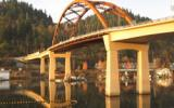 The Sauvie Island Bridge is a stunning 365-foot long steel tied arch main span with post-tensioned box girder approach spans.