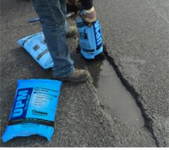 High-performance cold-mix asphalt repair material