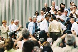 Bush shakes hands after signing SAFETEA-LU.