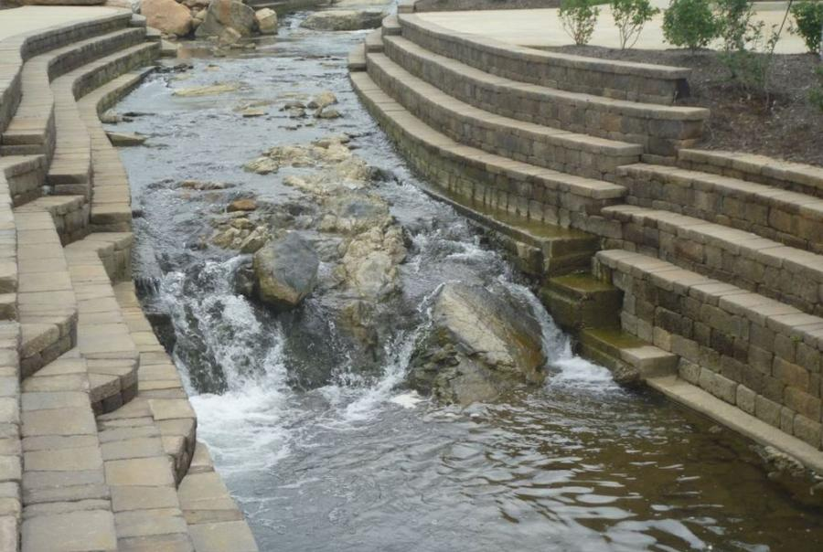 The new retaining wall stabilized the stream to withstand water flow.