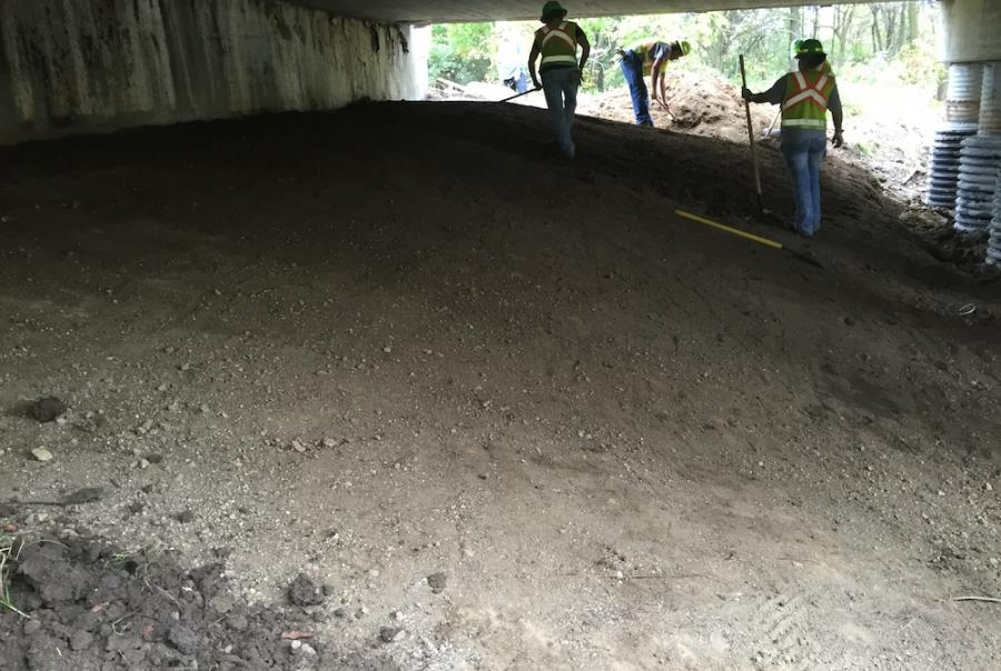 The surface was restored prior to installation by removing rocks and smoothing out the area.