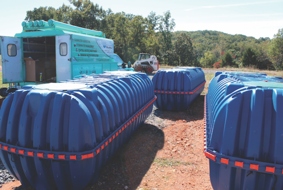 The underground storage tanks were placed in a grass-covered section of the backyard.
