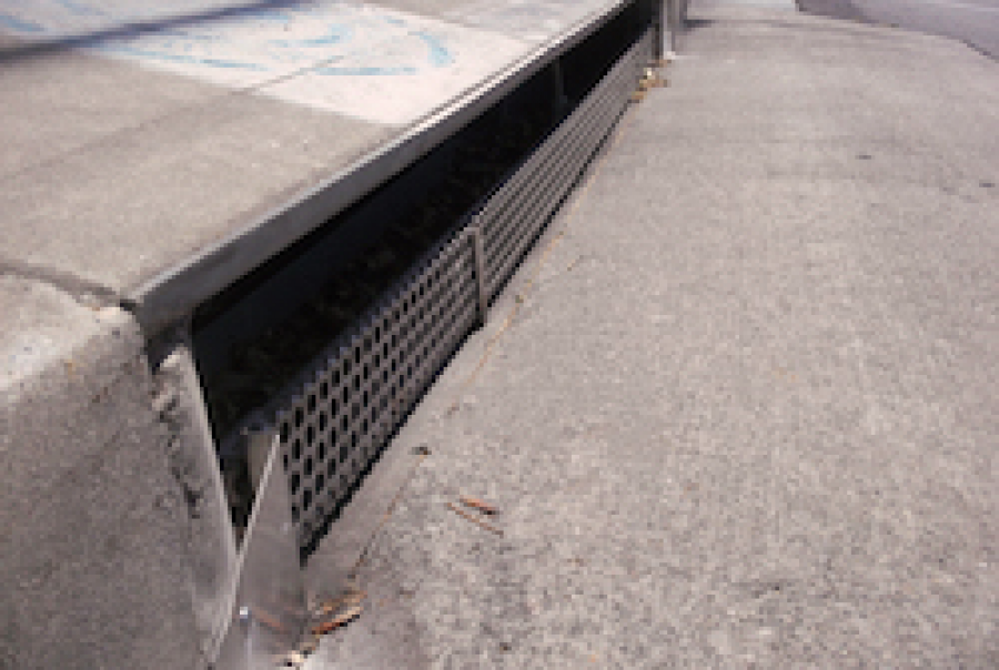 Curb guard filters storm water runoff and debris, made by Bio Clean