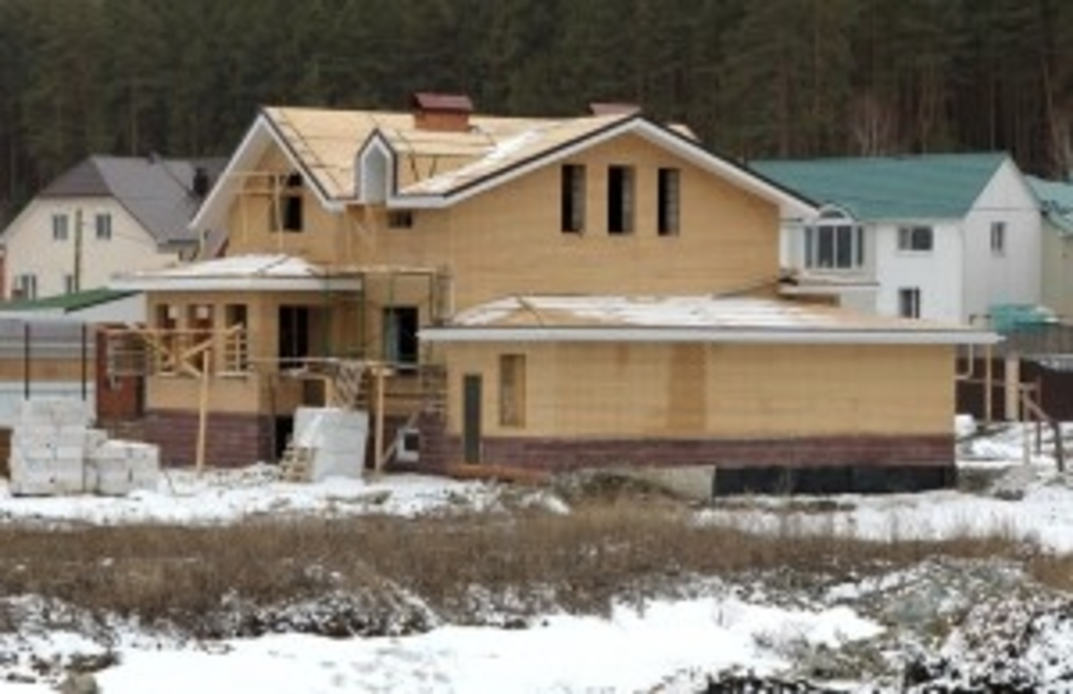 Home in Construction Covered in Snow