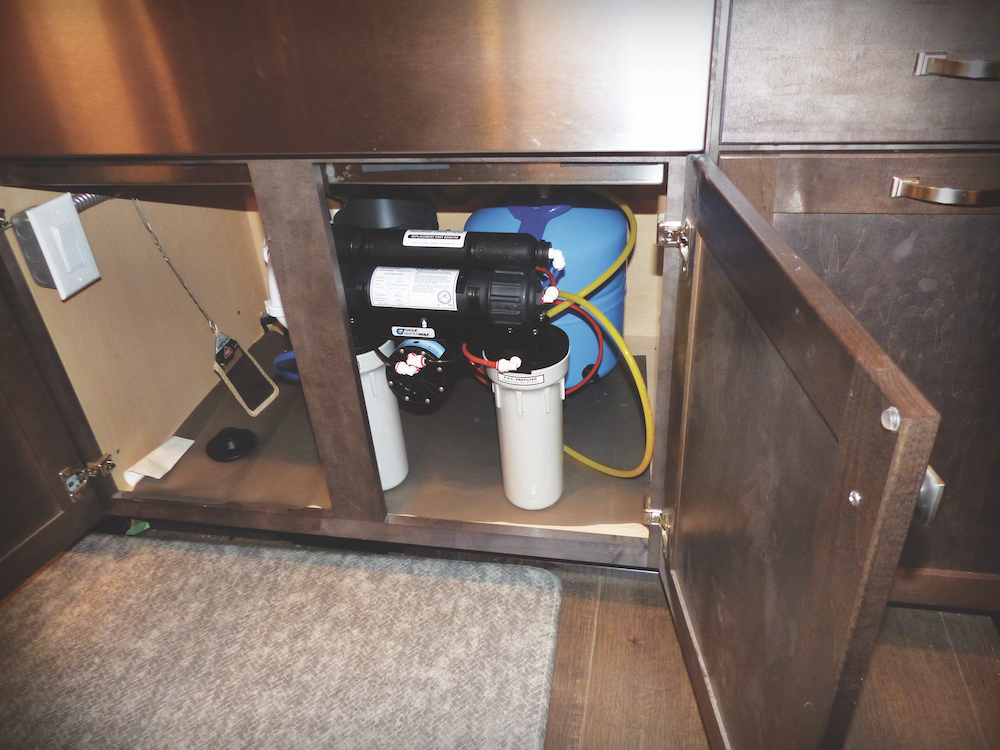 The family's reverse osmosis tank is larger than most to ensure they have enough stored, treated water on hand for safe drinking and cooking. The customer purchased a five-year supply of replacement filters.
