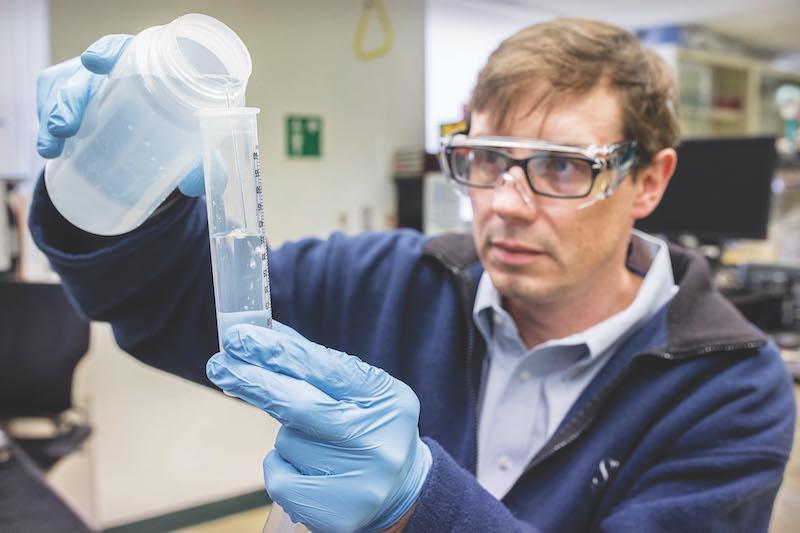 A researcher analyzes the aquarium's water.