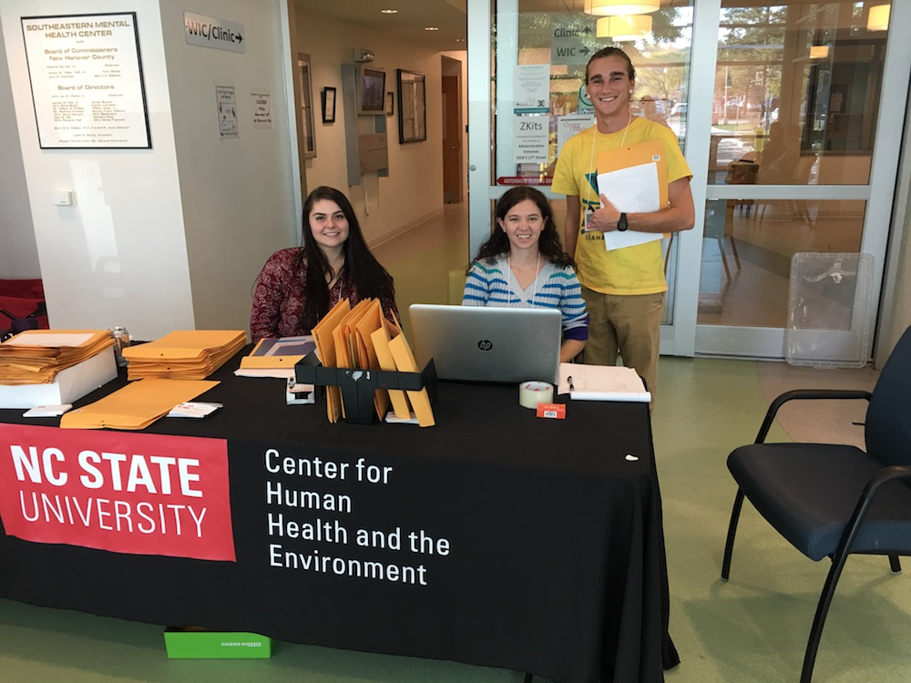 Team members from North Carolina State University at welcome tables during the sample collections compiled participant information.
