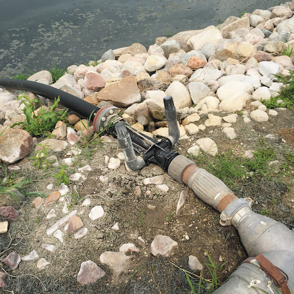 Twin air intakes feed a Venturi injector at the edge of a food processing company's wastewater lagoon.