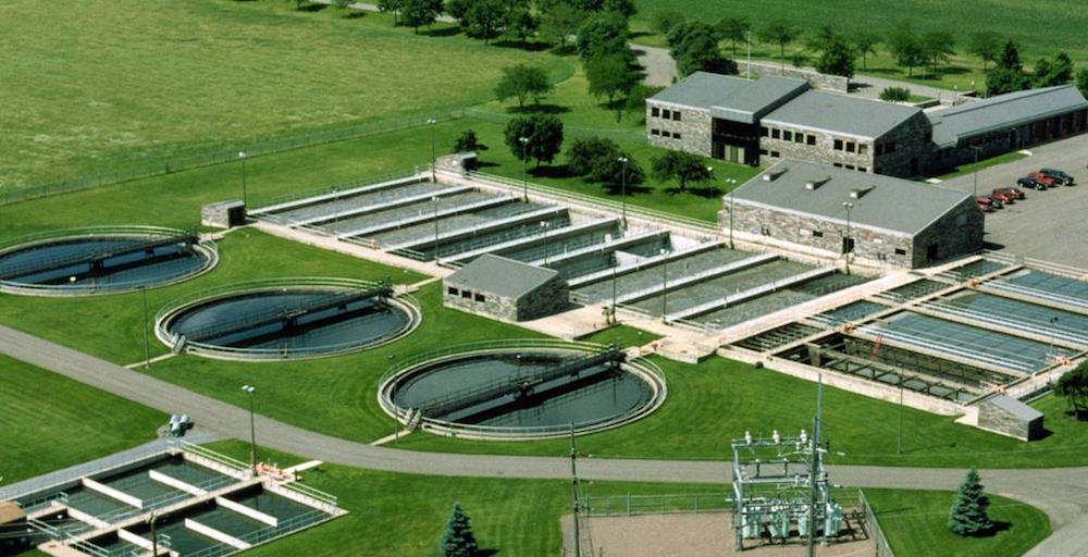 Jacob Ethen and Steve Cox write on flowmeters at a Minnesota facility