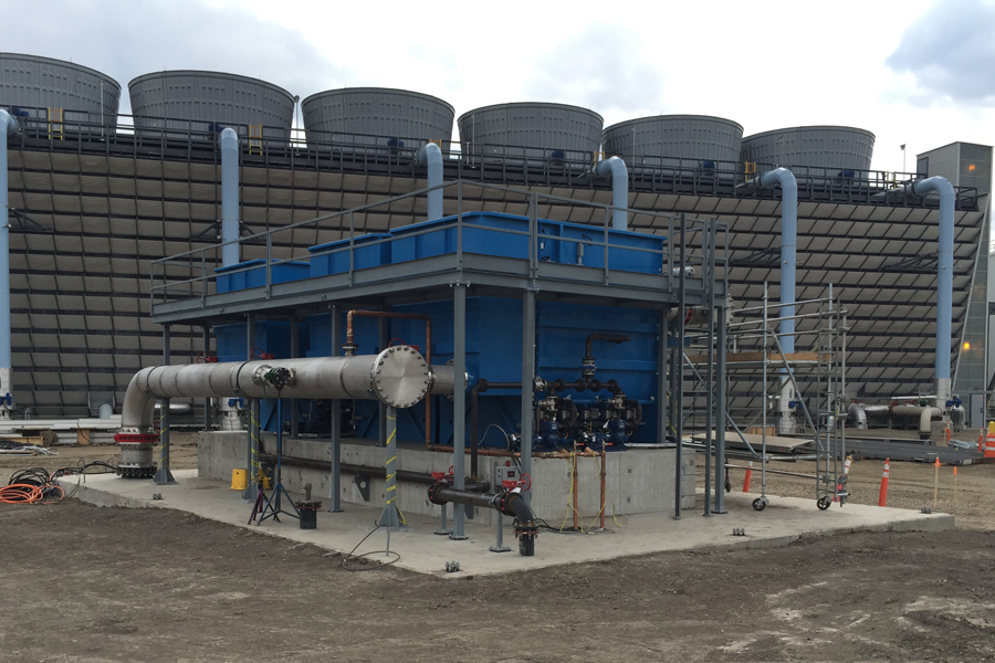 Overview of the three eight-disk AquaDisk filter units located adjacent to Shepard Energy Centre's cooling towers