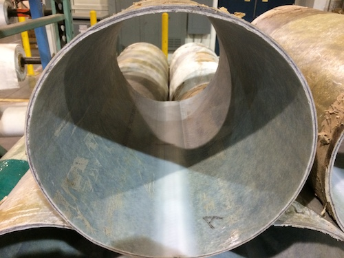 The picture shows the inside of a final cured test sample of carbon fiber reinforced CIPP.