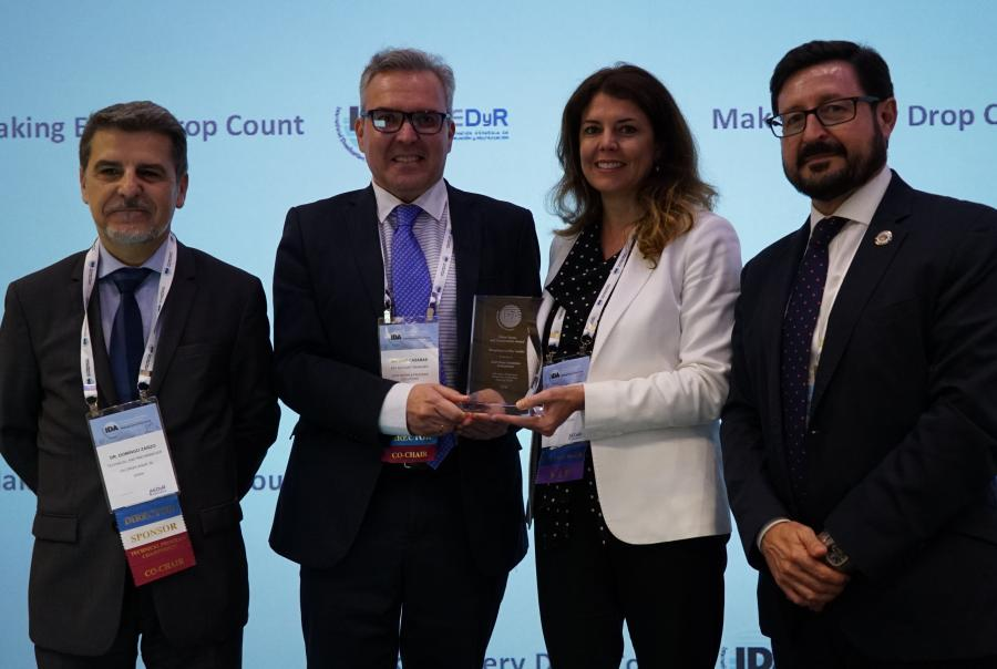 Antonio Casañas, key account manager, accepts a 2018 International Desalination Assn. Water Reuse and Conservation Award on behalf of Dow Water Solutions.
