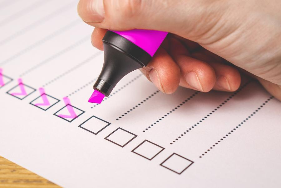 A reader fills out a survey with a pink highlighter.